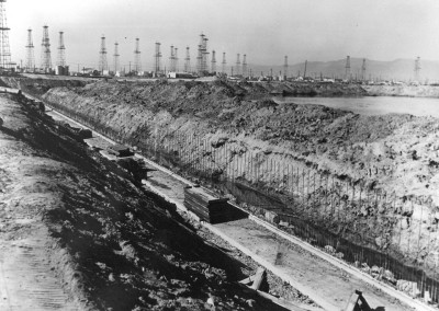 1967 Seawall construction  showing oil derricks on Venice Peninsula in the background.
