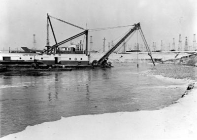 dredging-begins-dredging-barge-oil-derriks-in-background-1-60-hm224bw-edited