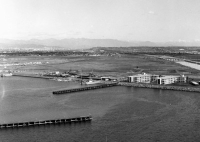 Temporary Baffles were build in the Marina in 1963 to protect the harbor from further storm damage. Businesses came back and boats went back in the water.
